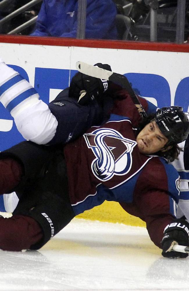 Colorado Avalanche right wing Steve Downie, front, gets tangled up with Winnipeg Jets defenseman Dustin Byfuglien while fighting for control of the puck in the second period of an NHL hockey game in Denver on Sunday, Oct. 27, 2013