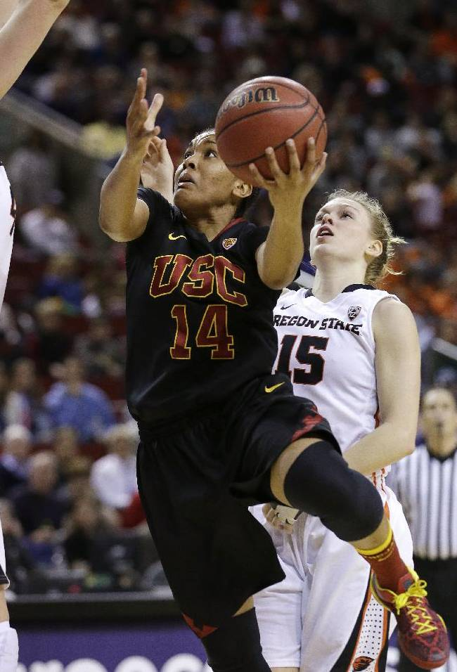 Southern California's Ariya Crook (14) drives the lane in front of Oregon States's Jamie Weisner in the second half of the Pac-12 NCAA college championship basketball game Sunday, March 9, 2014, in Seattle.  USC won 71-62