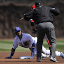 Chicago Cubs' Emilio Bonifacio looks for the call after stealing second base during the first inning of a baseball game against the Cincinnati Reds in Chicago, Sunday, April 20, 2014. Cincinnati won 8-2 The Associated Press