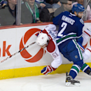 Vancouver Canucks' Dan Hamhuis (2) checks Montreal Canadiens' David Desharnais during the second period of an NHL hockey game, Thursday, Oct. 30, 2014 in Vancouver, British Columbia The Associated Press