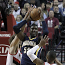 Indiana Pacers center Roy Hibbert, middle, is double teamed by the Portland Trail Blazers' Damian Lillard, right, and Robin Lopez during the first half of an NBA basketball game in Portland, Ore., Monday, Dec. 2, 2013 The Associated Press