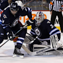 Winnipeg Jets' Zach Bogosian (44) and Florida Panthers' Brad Boyes (24) vie for the puck in front of Jets goaltender Michael Hutchinson (34) during the first period of an NHL hockey game Tuesday, Jan. 13, 2015, in Winnipeg, Manitoba The Associated Press
