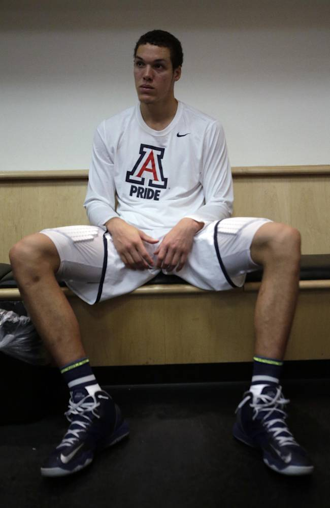 Arizona forward Aaron Gordon sits in the locker room after a regional final NCAA college basketball tournament game against Wisconsin, Saturday, March 29, 2014, in Anaheim, Calif. Wisconsin won 64-63 in overtime