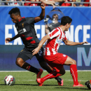 IMAGE DISTRIBUTED FOR GUINNESS INTERNATIONAL CHAMPIONS CUP - Liverpool FC's Daniel Sturridge (15) moves the ball past an Olympiacos player during the 2014 Guinness International Champions Cup, on Sunday, July 27, 2014 in Chicago, Ill. Liverpool FC defeate
