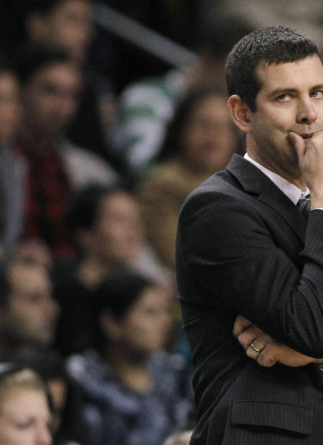 Boston Celtics head coach Brad Stevens looks toward his players during the second half of an NBA basketball game against the Los Angeles Lakers in Boston, Friday, Jan. 17, 2014.  The Lakers defeated the Celtics 107-104