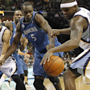Memphis Grizzlies forwards Tayshaun Prince (21) and Zach Randolph (50) try to grab a rebound away from Minnesota Timberwolves center Gorgui Dieng (5), of Senegal, in the first half of an NBA basketball game Monday, March 24, 2014, in Memphis, Tenn The Ass