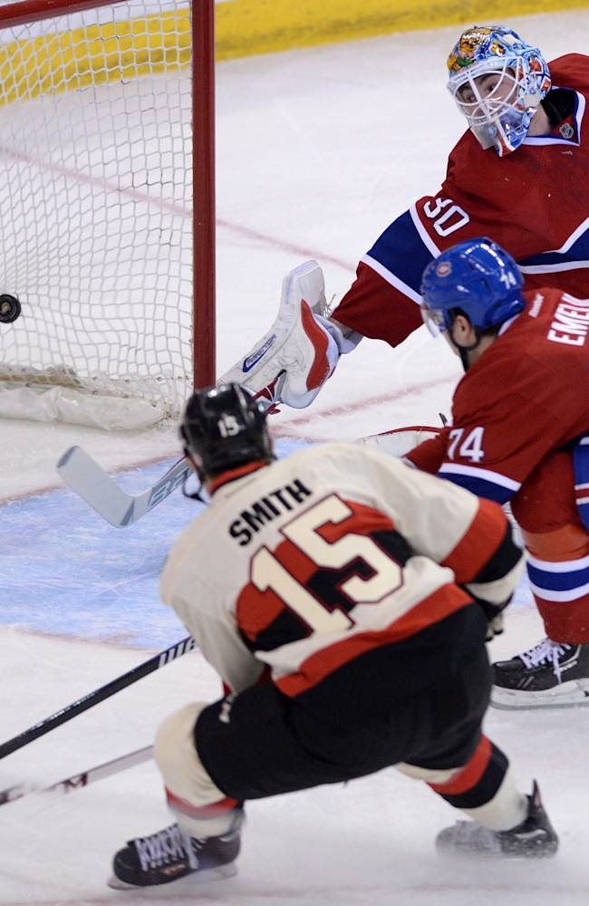 CORRECTS DATE TO FRIDAY APRIL 4 - Ottawa Senators forward Zack Smith (15) blasts the puck past Montreal Canadiens goalie Peter Budaj and defenseman Alexei Emelin during first period NHL hockey action in Ottawa on Friday, April 4, 2014