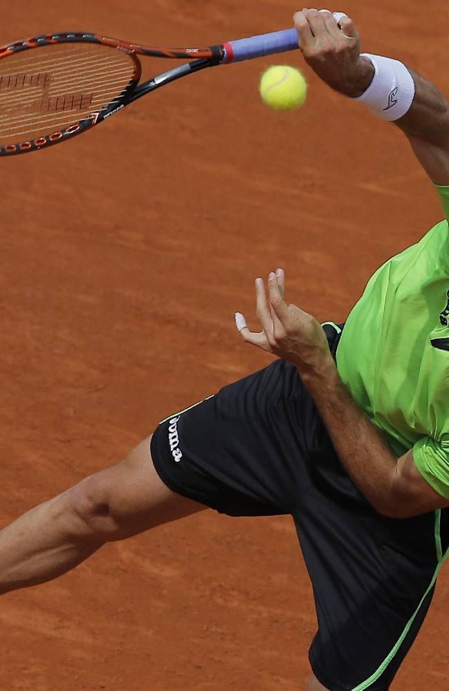 Spain's Marcel Granollers serves the ball during the fourth round match of the French Open tennis tournament against Canada's Milos Raonic at the Roland Garros stadium, in Paris, France, Sunday, June 1, 2014