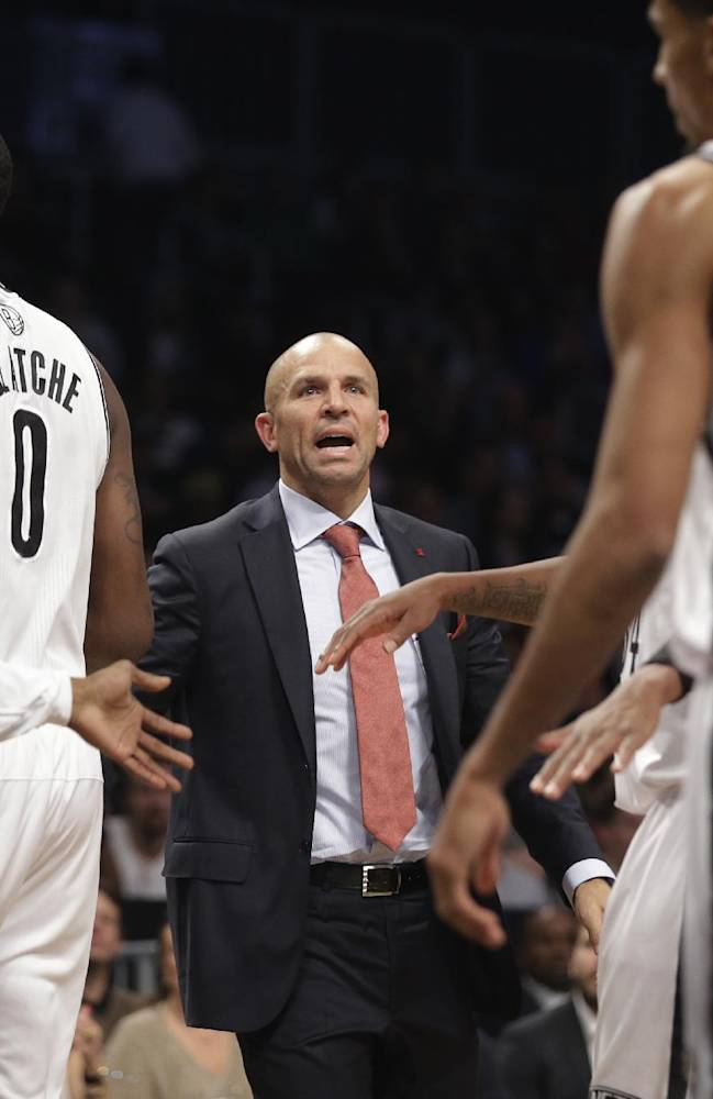 Brooklyn Nets head coach Jason Kidd talks to his team during the first half of an NBA basketball game against the Miami Heat Thursday, Oct. 17, 2013 in New York
