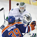 Vancouver Canucks goalie Eddie Lack (31) makes a save against Edmonton Oilers' Bogdan Yakimov (39) during the third period of a preseason NHL hockey hockey game Thursday, Oct. 2, 2014, in Edmonton, Alberta The Associated Press