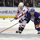 Washington Capitals' Mikhail Grabovski (84) and New York Islanders' Frans Nielsen (51) battle for the puck in the first period of an NHL hockey game on Saturday, April 5, 2014, in Uniondale, N.Y The Associated Press