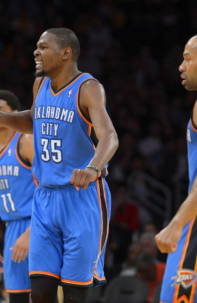 Oklahoma City Thunder small forward Kevin Durant, center, celebrates between shooting guard Jeremy Lamb, left, and point guard Derek Fisher during the second half of an NBA basketball game against the Los Angeles Lakers, Thursday, Feb. 13, 2014, in Los Angeles