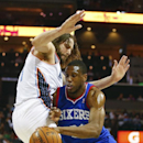Philadelphia 76ers forward Thaddeus Young, right, works to drive against Charlotte Bobcats forward Josh McRoberts, left, during the second half of an NBA basketball game in Charlotte, N.C., Saturday, April 12, 2014 The Associated Press