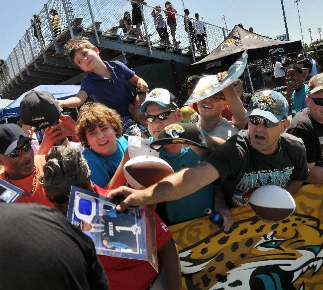 Fans struggle to get an autograph from Jacksonville Jaguars quarterback Blake Bortles after the second day of NFL rookie minicamp, Saturday, May 17, 2014, in Jacksonville, Fla