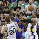 New York Knicks' Tyson Chandler (6) battles for a loose ball with Utah Jazz's Gordon Hayward (20) and Derrick Favors, right, in the fourth quarter during an NBA basketball game Monday, March 31, 2014, in Salt Lake City The Associated Press