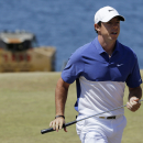 """FILE - A Sunday, June 21, 2015 file photo showing Rory McIlroy, of Northern Ireland, walking off the second green during the final round of the U.S. Open golf tournament at Chambers Bay in University Place, Wash. World number one Rory McIlroy has ruptured a ligament in his left ankle while playing soccer less than before the start of his British Open title defense. The Northern Irish golfer gave no indication how long he would be out in the announcement Monday, July 6, 2015, on his Instagram account, only saying that he is """"working hard to get back as soon as I can."""" (AP Photo/Ted S. Warren, File)"""