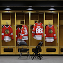 Chicago Blackhawks jerseys of Jonathan Toews (19) and Patrick Kane (88) hang in a locker room before an NHL hockey news conference at the United Center in Chicago, Wednesday, July 16, 2014. The Blackhawks recently agreed to eight-year contract extensions