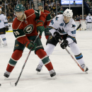 Minnesota Wild defenseman Nate Prosser (39) and San Jose Sharks center Tomas Hertl (48), of the Czech Republic, chase the puck during the second period of an NHL hockey game in St. Paul, Minn., Thursday, Oct. 30, 2014 The Associated Press