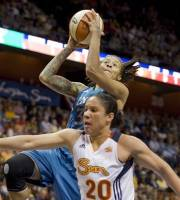 Minnesota Lynx' Seimone Augustus goes up for a basket while guarded by Connecticut Sun's Kara Lawson (20) during the first half of WNBA basketball game in Uncasville, Conn., Friday, June 1, 2012. (AP Photo/Jessica Hill)