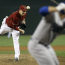 Arizona Diamondbacks' Trevor Cahill, left, delivers a pitch to Los Angeles Dodgers' Tim Federowicz during the second inning of a baseball game on Sunday, April 13, 2014, in Phoenix The Associated Press