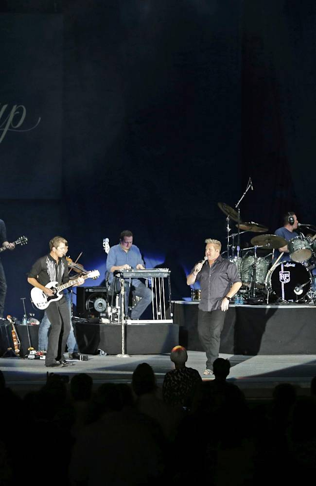 The country music group Rascal Flatts plays during the opening ceremony for the Presidents Cup golf tournament at Columbus Commons Wednesday, Oct. 2, 2013, in Columbus, Ohio