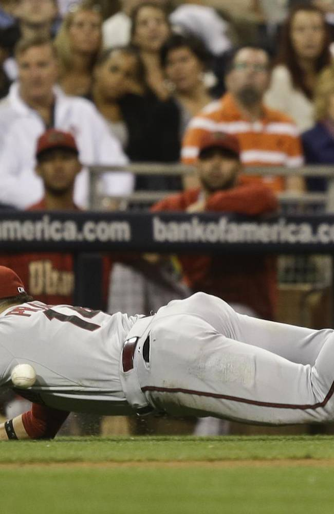 Arizona Diamondbacks third baseman Martin Prado can't make the diving catch on a bunt attempt by San Diego Padres' Jesus Guzman in the eighth inning of a baseball game Tuesday, Sept. 24, 2013, in San Diego