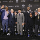 Members of the NFL Pro Football Hall of Fame class of 2015 are introduced Saturday, Jan. 31, 2015, in Tempe, Ariz. From left are running back Jerome Bettis; wide receiver Tim Brown; defensive end and linebacker Charles Haley; Bill Polian; Tyler Seau, son of the late linebacker Junior Seau, on behalf of his father; guard Will Shields; center Mick Tingelhoff; and Ron Wolf. (AP Photo/Mark Humphrey)