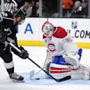 Los Angeles Kings right wing Marian Gaborik, left, of Slovakia, tries to get a shot in on Montreal Canadiens goalie Dustin Tokarski during the second period of an NHL hockey game, Thursday, March 5, 2015, in Los Angeles. (AP Photo/Mark J. Terrill)