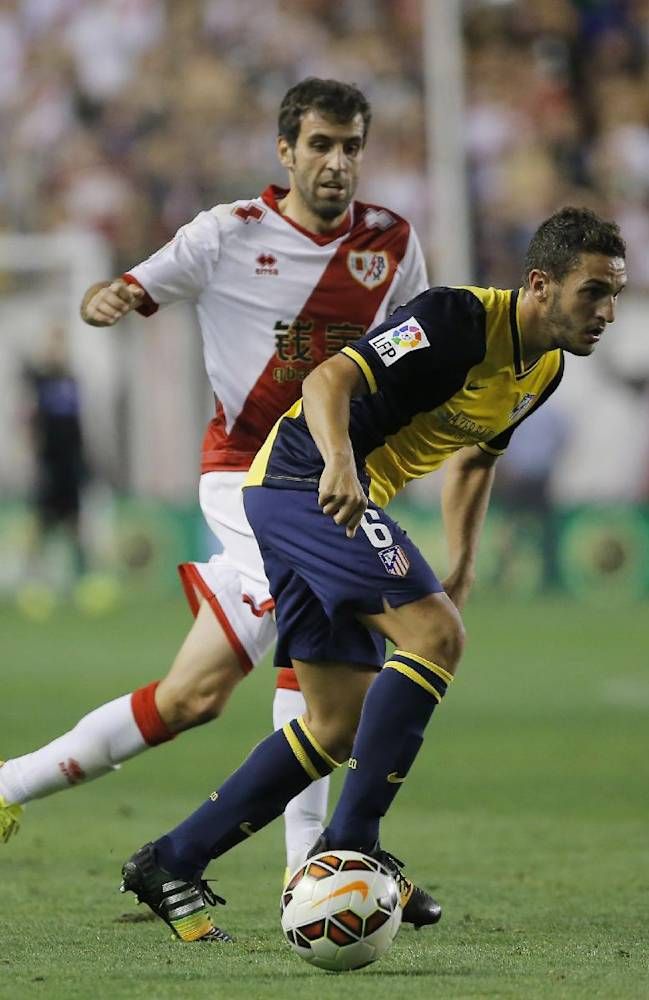 Atletico's Koke controls the ball during a Spanish La Liga soccer match between Rayo Vallecano and Atletico Madrid at the Vallecas stadium in Madrid, Spain, Monday, Aug. 25, 2014