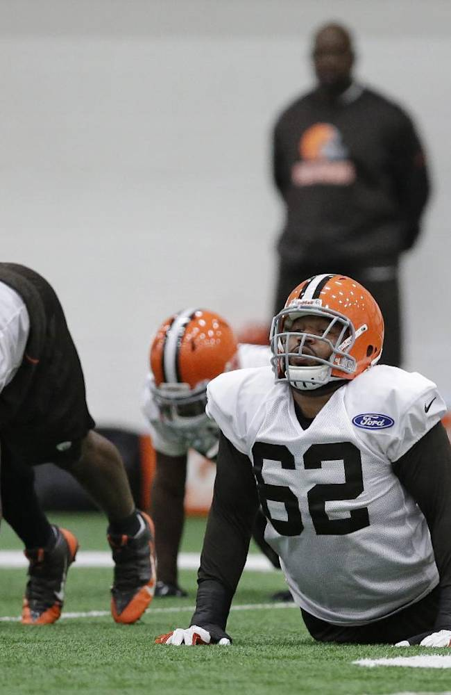 Cleveland Browns guard Jason Pinkston (62) warms up before practice at the NFL football team's facility in Berea, Ohio Wednesday, Oct. 16, 2013. Pinkston is recovering from an ankle sprain that has sidelined him for the first part of the season