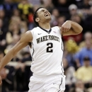 Wake Forest's Devin Thomas (2) react after a basket against North Carolina State during the second half of an NCAA college basketball game in Winston-Salem, N.C., Tuesday, Jan. 22, 2013. Wake Forest won 86-84. (AP Photo/Chuck Burton)