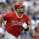 In this June 26, 2013, file photo, Los Angeles Angels' Albert Pujols watches after batting against the Detroit Tigers in the third inning of a baseball game in Detroit. Radio host and former Cardinals player Jack Clark has apologized for and retracted com