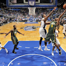 Favors, Hayward lead Jazz over Magic 101-94 The Associated Press