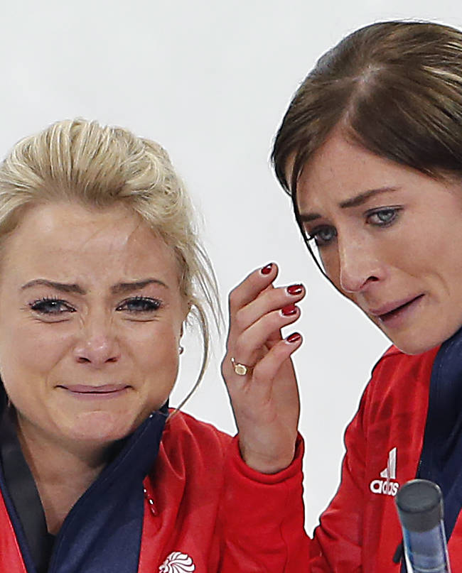 Britain's skip Eve Muirhead, right, and Anna Sloan, left, cry as they celebrate beating Switzerland in the women's curling bronze medal game at the 2014 Winter Olympics, Thursday, Feb. 20, 2014, in Sochi, Russia