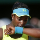 Sloane Stephens, of the U.S, wipes her face as she  plays Russia's Maria Sharapova during their fourth round match of the French Open tennis tournament at the Roland Garros stadium Monday, June 3, 2013 in Paris. (AP Photo/Michel Spingler)