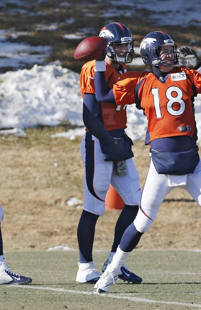 Denver Broncos quarterback Peyton Manning (18) throws a pass at practice for the football team's NFL playoff game against the San Diego Chargers at the Broncos training facility in Englewood, Colo., on Wednesday, Jan. 8, 2014. Backup quarterbacks Zac Dysert (2) and Brock Osweiler (17) watch