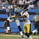 Carolina Panthers' Kelvin Benjamin (13) catches a pass as Pittsburgh Steelers' Cortez Allen (28) defends during the second half of an NFL football game in Charlotte, N.C., Sunday, Sept. 21, 2014 The Associated Press