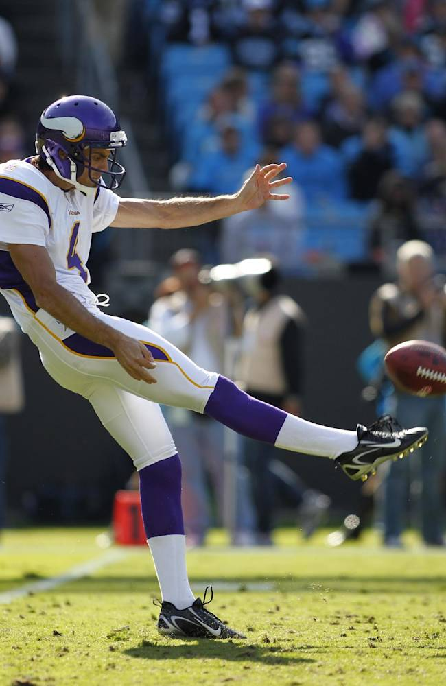 In this Oct. 30, 2011, photo, Minnesota Vikings' Chris Kluwe punts to the Carolina Panthers during an NFL football game in Charlotte, N.C. Kluwe, who is no longer with the Vikings, says the team's special teams coordinator, Mike Priefer, made anti-gay comments while Kluwe was with the team