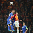 Burak Yilmaz of Galatasaray, right, and Gary Cahill of Chelsea fight for the ball during their Champions League Round of 16, First Leg soccer match between Galatasaray and Chelsea at Turk Telekom Arena Stadium in Istanbul, Turkey, Wednesday, Feb. 26, 2014