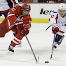 Carolina Hurricanes' Eric Staal (12) and Washington Capitals' Dmitry Orlov (81), of Russia, chase the puck during the second period of an NHL hockey game in Raleigh, N.C., Thursday, April 10, 2014 The Associated Press