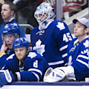 Toronto Maple Leafs goalie Jonathan Bernier (45) and James Reimer, right, watch from the bench with Jake Gardiner, left, and Tim Gleason (8) after Bernier was pulled in the last minutes of the game against the St. Louis Blues during third period NHL hock