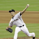 In this Sept. 18, 2014, file photo, Miami Marlins relief pitcher Dan Jennings (43) pitches against the Washington Nationals during a baseball game in Miami. Dan Jennings traded Dan Jennings. On the final day of the winter meetings, the Miami Marlins sent