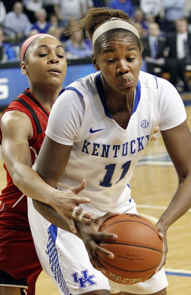 Kentucky's DeNesha Stallworth (11) is pressured by Louisville's Bria Smith during the second half of an NCAA college basketball game, Sunday, Dec. 1, 2013, in Lexington, Ky. Kentucky won 69-64