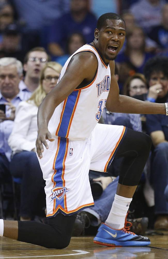 Oklahoma City Thunder forward Kevin Durant gestures to an official during the first quarter of an NBA basketball preseason game against the New Orleans Pelicans in Tulsa, Okla., Thursday, Oct. 17, 2013