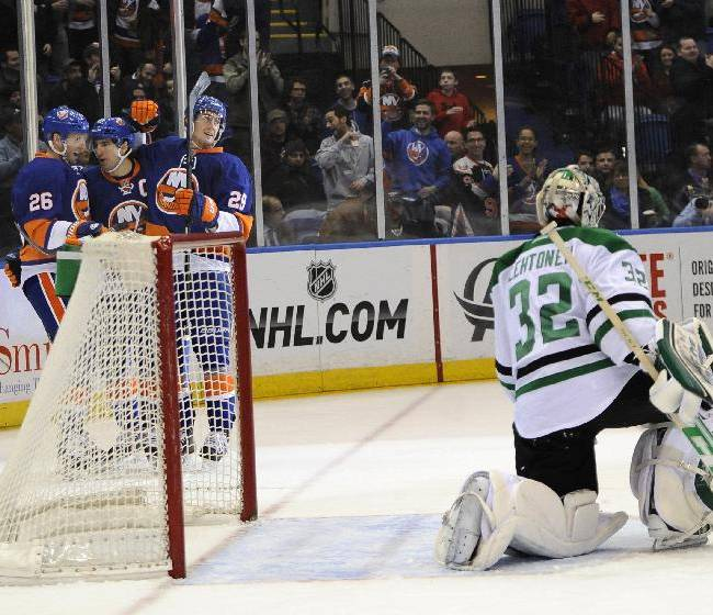 New York Islanders' Thomas Vanek (26), John Tavares (91) and Brock Nelson (29) celebrate a goal scored by Tavares against Dallas Stars goalie Kari Lehtonen (32) in the second period of an NHL hockey game on Monday, Jan. 6, 2014, in Uniondale, N.Y