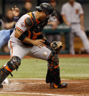 San Francisco Giants catcher Guillermo Quiroz cannot handle the throw home as Tampa Bay Rays' Yunel Escobar slides in to score behind him during the sixth inning of an interleague baseball game Sunday, Aug. 4, 2013, in St. Petersburg, Fla. (AP Photo/Mike Carlson)