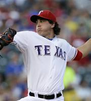 Texas Rangers starting pitcher Derek Holland delivers to the Seattle Mariners in the first inning of a baseball game, Friday, Aug. 16, 2013, in Arlington, Texas. (AP Photo/Tony Gutierrez)