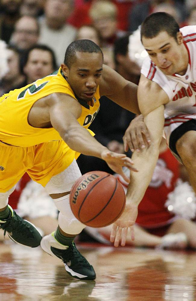 Ohio State's Aaron Craft (4) ,right, and North Dakota State's Lawrence Alexander (12) scramble for a loose ball during the first half of an NCAA college basketball game, Saturday, Dec. 14, 2013, in Columbus, Ohio