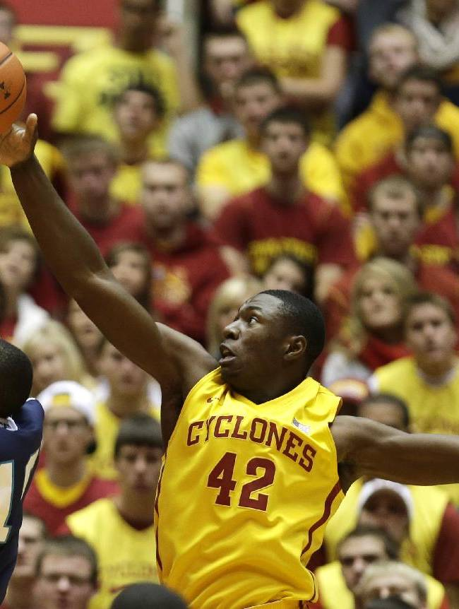 Iowa State forward Daniel Edozie (42) blocks a shot by UNC Wilmington guard Freddie Jackson during the first half of an NCAA college basketball game, Sunday, Nov. 10, 2013, in Ames, Iowa