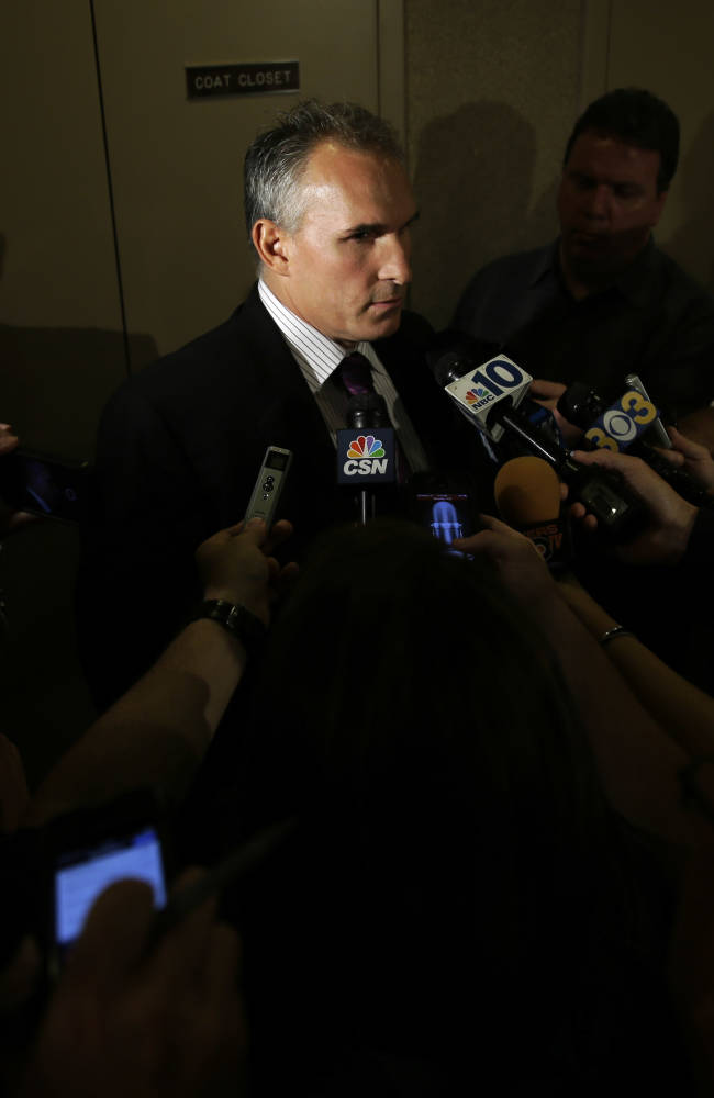 Craig Berube, newly-hired Philadelphia Flyers head coach talks with the media after an NHL hockey news conference, Monday, Oct. 7, 2013, in Philadelphia. The Flyers fired coach Peter Laviolette after an 0-3 start and a preseason vote of confidence from ownership and hired Berube